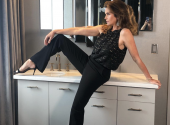 Gorgeous 53-year-old  Cindy Crawford wearing a pantsuit on the naked body